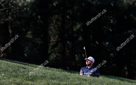 Stock Picture of Tyrrell Hatton of Britain prepares an approach shot during the third round of the CJ Cup at the Nine Bridges PGA tour golf tournament at Nine Brid?ges Golf Club in Jeju, South Korea, 19 October 2019.
