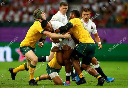 England vs Australia. England's Manu Tuilagi tackled by David Pocock, Christian Lealiifano and Samu Kerevi of Australia