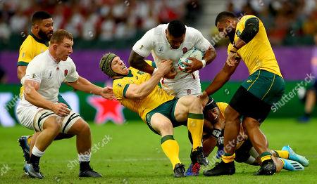 Stock Photo of England vs Australia. England's Manu Tuilagi tackled by David Pocock and Samu Kerevio of Australia
