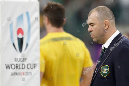 Australia coach Michael Cheika watches as his team warm up before the Rugby World Cup quarterfinal match at Oita Stadium between England and Australia in Oita, Japan