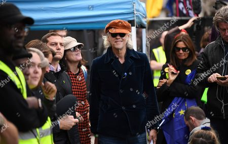 Singer-songwriter Bob Geldof attends an anti-Brexit protest gathering in London, . In a major blow to British Prime Minister Boris Johnson, U.K. lawmakers voted Saturday to postpone a decision on whether to back his Brexit deal with the European Union, throwing a wrench into government plans to leave the bloc at the end of this month