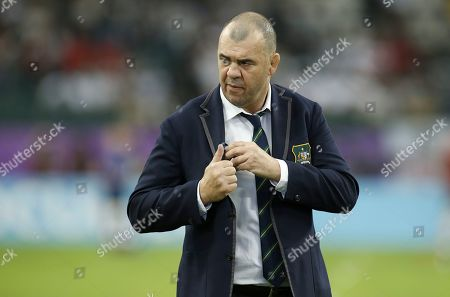 Australia head coach Michael Cheika (C) looks on ahead of the Rugby World Cup match between England and Australia, in Oita, Japan, 19 October 2019.