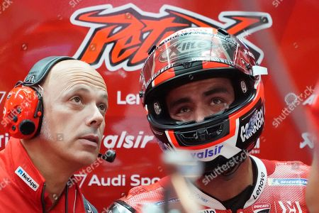 Italian MotoGP rider Danilo Petrucci of Ducati Team talks with his team staff during a free practice session of MotoGP Motorcycling Grand Prix of Japan at Twin Ring Motegi in Motegi, Tochigi Prefecture, north of Tokyo, 19 October 2019.Â