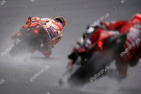 Spanish MotoGP rider Jorge Lorenzo (L) of Repsol Honda Team and Italian MotoGP rider Andrea Dovizioso of Ducati Team in action during a free practice session of MotoGP Motorcycling Grand Prix of Japan at Twin Ring Motegi in Motegi, Tochigi Prefecture, north of Tokyo, 19 October 2019.