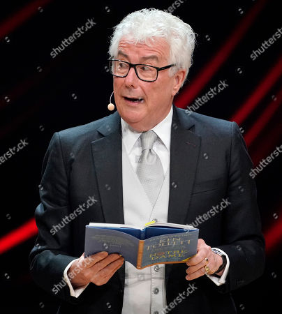 Stock Picture of British author Ken Follett from from his book 'Notre-Dame' during the Literatur gala at the book fair Frankfurter Buchmesse 2019, in Frankfurt am Main, Germany, 19 October 2019. The 71st edition of the international Frankfurt Book Fair, described as the world's most important fair for the print and digital content business, runs from 16 to 20 October and gathers authors, writers and celebrities from all over the world. This year's Guest of Honour country is Norway.