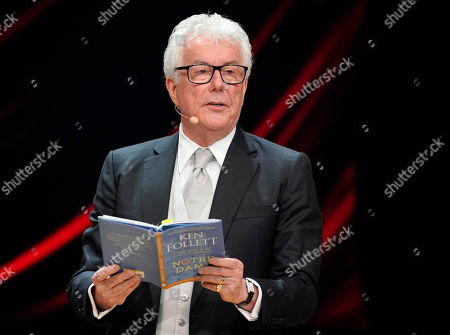 Stock Image of British author Ken Follett from from his book 'Notre-Dame' during the Literatur gala at the book fair Frankfurter Buchmesse 2019, in Frankfurt am Main, Germany, 19 October 2019. The 71st edition of the international Frankfurt Book Fair, described as the world's most important fair for the print and digital content business, runs from 16 to 20 October and gathers authors, writers and celebrities from all over the world. This year's Guest of Honour country is Norway.