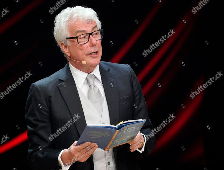 Stock Photo of British author Ken Follett from from his book 'Notre-Dame' during the Literatur gala at the book fair Frankfurter Buchmesse 2019, in Frankfurt am Main, Germany, 19 October 2019. The 71st edition of the international Frankfurt Book Fair, described as the world's most important fair for the print and digital content business, runs from 16 to 20 October and gathers authors, writers and celebrities from all over the world. This year's Guest of Honour country is Norway.