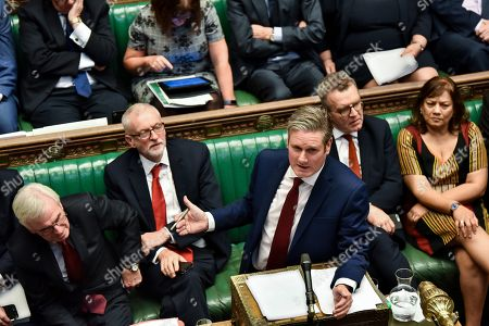 A handout picture made available by the UK Parliament shows Labour Party shadow Secretary of State for Exiting the EU Keir Starmer (C) delivering a statement during a debate on the revised Brexit deal at the House of Commons in London, Britain, 19 October 2019. The MP's voted to delay the approval of a Brexit deal.