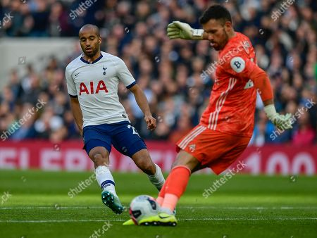Lucas Moura of Tottenham Hotspur closing down on Ben Foster of Watford