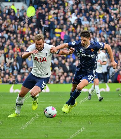 Harry Kane of Tottenham Hotspur battles for the ball with Craig Cathcart of Watford