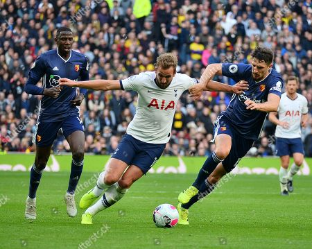 Stock Photo of Harry Kane of Tottenham Hotspur battles for the ball with Craig Cathcart of Watford