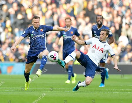 Stock Picture of Tom Cleverley of Watford battles for the ball with Harry Winks of Tottenham Hotspur