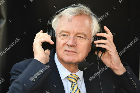 Former Brexit Secretary David Davis is seen during a radio interview in Westminster