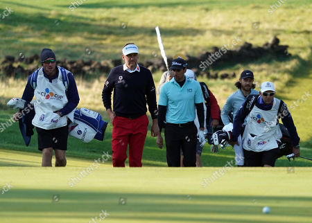 Ian Poulter (ENG), (center lef) and Rafa Cabrera-Bello (ESP)