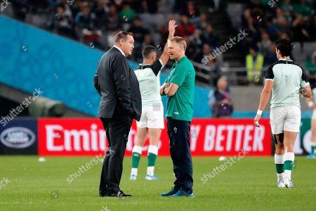 New Zealand coach Steve Hansen, left, and Ireland coach Joe Schmidt, right, talk ahead of the Rugby World Cup quarterfinal match at Tokyo Stadium in Tokyo, Japan