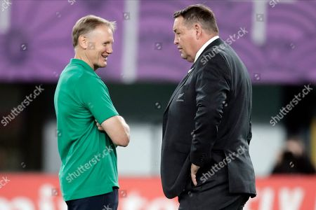 Ireland coach Joe Schmidt, left, talks to New Zealand coach Steve Hansen before the Rugby World Cup quarterfinal match at Tokyo Stadium between New Zealand and Ireland in Tokyo, Japan