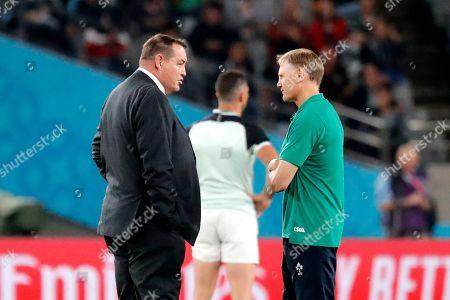 New Zealand coach Steve Hansen, left, talks to Ireland coach Joe Schmidt before during the Rugby World Cup quarterfinal match at Tokyo Stadium between New Zealand and Ireland in Tokyo, Japan