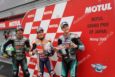 Stock Picture of Japan MotoGP. Left to right; Italy's MotoGP rider Valentino Rossi, Spain's Marc Marquez and France's MotoGP rider Fabio Quartararo pose for photographers after obtaining pole positions during the qualifying round of the MotoGP Japanese Motorcycle Grand Prix at the Twin Ring Motegi circuit in Motegi, north of Tokyo