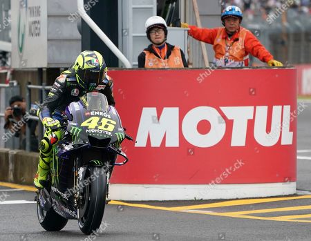 Stock Photo of Japan MotoGP. Italy's MotoGP rider Valentino Rossi during the start of the official qualifying round of the MotoGP Japanese Motorcycle Grand Prix at the Twin Ring Motegi circuit in Motegi, north of Tokyo