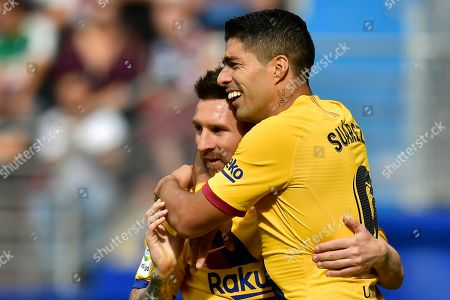 Stock Photo of Barcelona's Luis Suarez, celebrates after scoring his side's third goal with Lionel Messi during a Spanish La Liga soccer match between Eibar and FC Barcelona at the Ipurua stadium in Eibar, Spain