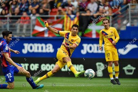 Stock Picture of Barcelona's Luis Suarez shoots on goal during a Spanish La Liga soccer match between Eibar and FC Barcelona at the Ipurua stadium in Eibar, Spain