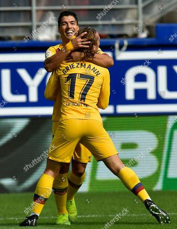 Barcelona's Antoine Griezmann, front, celebrates with Luis Suarez after scoring the opening goal during a Spanish La Liga soccer match between Eibar and FC Barcelona at the Ipurua stadium in Eibar, Spain