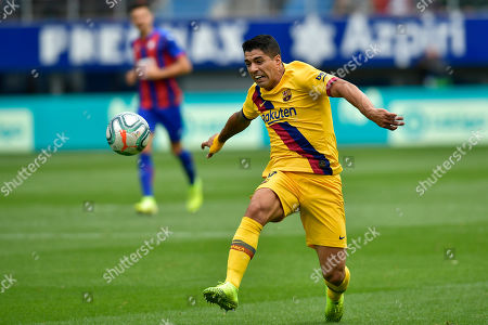 Barcelona's Luis Suarez chases the ball during a Spanish La Liga soccer match between Eibar and FC Barcelona at the Ipurua stadium in Eibar, Spain