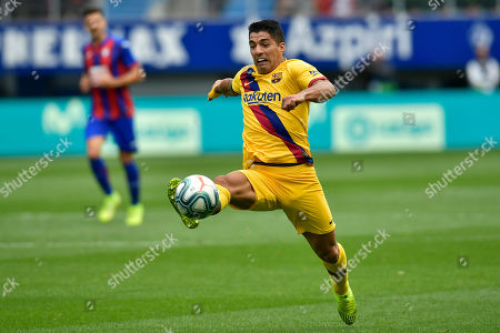 Barcelona's Luis Suarez controls the ball during a Spanish La Liga soccer match between Eibar and FC Barcelona at the Ipurua stadium in Eibar, Spain