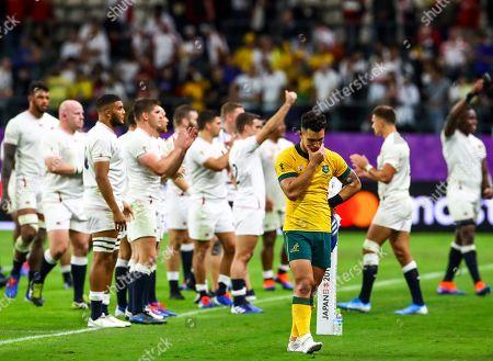 2019 Rugby World Cup Quarter-Final, Oita Stadium, Kyushu Island, Japan 19/10/2019. England vs Australia. Matt To'omua of Australia dejected as England players celebrate