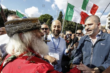 Stock Photo of Simone Di Stefano (R), leader of Casapound, a far right movement, attends an anti-government rally called for by the Italian League party, in Rome, Italy, 19 October 2019. League party leader Matteo Salvini, who pulled the plug on the M5S-League government on 08 August citing M5S inaction, called the protest shortly after the inception of the new government formed by his former ally, the anti-establishment 5-Star Movement (M5S), and the centre-left Democratic Party (PD).