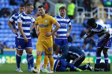 David Nugent (35) of Preston North End with Yakou Meite (19) of Reading recieving treatment during the EFL Sky Bet Championship match between Reading and Preston North End at the Madejski Stadium, Reading