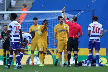 David Nugent (35) of Preston North End recieves a yellow card during the EFL Sky Bet Championship match between Reading and Preston North End at the Madejski Stadium, Reading