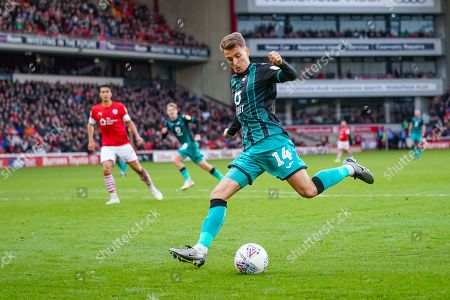 Swansea City midfielder Tom Carroll (14) in action during the EFL Sky Bet Championship match between Barnsley and Swansea City at Oakwell, Barnsley