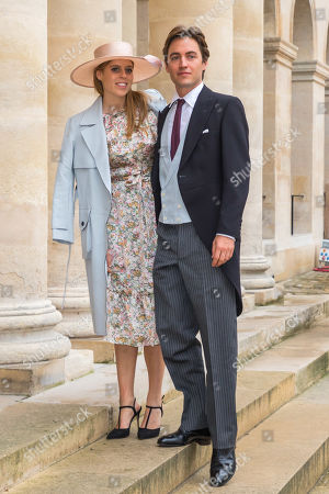 Britain's Princess Beatrice of York (L) and his betrothed Edoardo Mapelli Mozzi (R) arrive for the wedding ceremony of the Prince Napoleon Countess Arco-Zunneberg  at the Saint-Louis-des-Invalides cathedral at the Invalides National Hotel  in Paris, France, 19 October 2019.