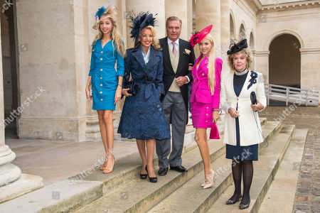 Charles of Bourbon-Two Sicilies (2-R) and his wife Princess Camilla of Bourbon-Two Sicilies (2-L) with their daughters Maria Chiara (L) and Maria Carolina of Bourbon-Two Sicilies (2-R) and and Edoarda Crociani (R) arrive to attend the wedding of prince Napoleon and Countess Olympia Arco-Zunneberg  at the Saint-Louis-des-Invalides cathedral at the Invalides National Hotel  in Paris, France, 19 October 2019.