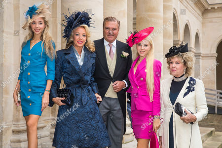 Stock Picture of Charles of Bourbon-Two Sicilies (2-R) and his wife Princess Camilla of Bourbon-Two Sicilies (2-L) with their daughters Maria Chiara (L) and Maria Carolina of Bourbon-Two Sicilies (2-R) and and Edoarda Crociani (R) arrive to attend the wedding of prince Napoleon and Countess Olympia Arco-Zunneberg  at the Saint-Louis-des-Invalides cathedral at the Invalides National Hotel  in Paris, France, 19 October 2019.