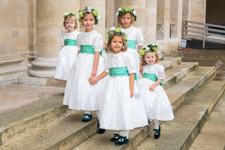 Wedding's Bridesmaids pose prior to the wedding ceremony of the Prince Napoleon with Countess Arco-Zunneberg  at the Saint-Louis-des-Invalides cathedral at the Invalides National Hotel  in Paris, France, 19 October 2019.
