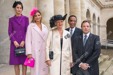 Princesse Anne of Bourbon-Two-Sicilia (C) poses with her husband Alexandre Ursulet (2-R) and family member as they arrive to attend the wedding ceremony of the Prince Napoleon with Countess Arco-Zunneberg (unseen) at the Saint-Louis-des-Invalides cathedral at the Invalides National Hotel  in Paris, France, 19 October 2019.