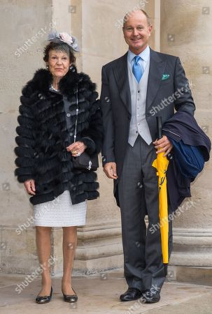 Stock Image of Princess Maria Pia of Italy (L) and her son Prince Dimitri of Yugoslavia pose outside the Saint-Louis-des-Invalides cathedral at the Invalides National Hotel in Paris, France, 19 October 2019, to attend the wedding ceremony of the Prince Napoleon with Countess Arco-Zunneberg (unseen).