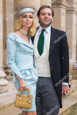 Stock Photo of Swiss-born British jewelry designer Sabine Getty and husband Joseph Getty of the Getty dynasty, pose outside the Saint-Louis-des-Invalides cathedral at the Invalides National Hotel in Paris, France, 19 October 2019, to attend the wedding ceremony of the Prince Napoleon with Countess Arco-Zunneberg (unseen).