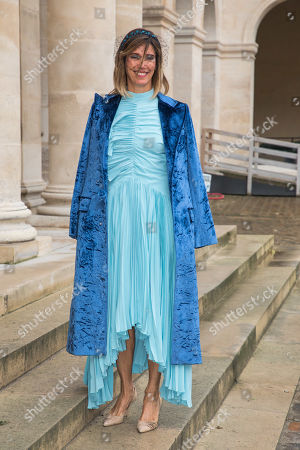 Stock Photo of Carolina Ruiseco poses outside the Saint-Louis-des-Invalides cathedral at the Invalides National Hotel in Paris, France, 19 October 2019, to attend the wedding ceremony of the Prince Napoleon with Countess Arco-Zunneberg (unseen).