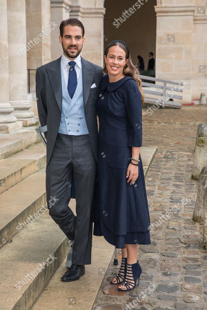 Prince Philippos of Greece and Denmark (L) and Nina Flohr (R), only child of Swiss billionaire Thomas Flohr, pose for photographs outside the Saint-Louis-des-Invalides cathedral at the Invalides National Hotel in Paris, France, 19 October 2019, to attend the wedding ceremony of the Prince Napoleon with Countess Arco-Zunneberg (unseen).