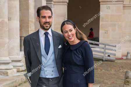 Stock Photo of Prince Philippos of Greece and Denmark (L) and Nina Flohr (R), only child of Swiss billionaire Thomas Flohr, pose for photographs outside the Saint-Louis-des-Invalides cathedral at the Invalides National Hotel in Paris, France, 19 October 2019, to attend the wedding ceremony of the Prince Napoleon with Countess Arco-Zunneberg (unseen).