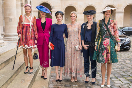 Stock Image of Princess Maria Laura of Belgium, Archduchess of Austria-Este (3-R) and guests pose outside the Saint-Louis-des-Invalides cathedral at the Invalides National Hotel in Paris, France, 19 October 2019, to attend the wedding ceremony of the Prince Napoleon with Countess Arco-Zunneberg (unseen).
