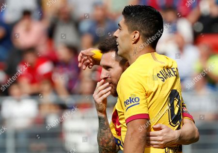 FC Barcelona's Luis Suarez (R) celebrates with teammate Lionel Messi (L) after scoring during the Spanish LaLiga soccer match between SD Eibar and FC Barcelona played at Ipurua stadium, in Eibar, northern Spain, 19 October 2019.