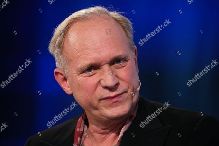 Stock Image of German actor Ulrich Tukur speaks during an interview at Frankfurt Book Fair 2019 in Frankfurt Main, Germany, 19 October, 2019. The 71st edition of the international Frankfurt Book Fair, described as the world's most important fair for the print and digital content business, runs from 16 to 20 October and gathers authors, writers and celebrities from all over the world.