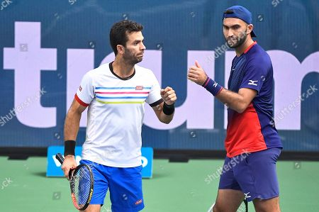 Jean-Julien Rojer (L) of the Netherlands and Horia Tecau of Romania during the men's doubles semifinal match against Mate Pavic of Croatia and Bruno Soares of Brazil at the ATP Stockholm Open tennis tournament at the Royal Tennis Hall in Stockholm, Sweden, 19 October 2019.