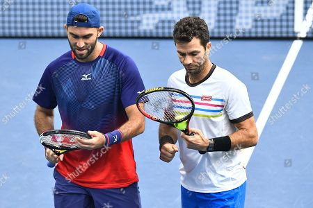 Jean-Julien Rojer (R) of the Netherlands and Horia Tecau of Romania during the men's doubles semifinal match against Mate Pavic of Croatia and Bruno Soares of Brazil at the ATP Stockholm Open tennis tournament at the Royal Tennis Hall in Stockholm, Sweden, 19 October 2019.