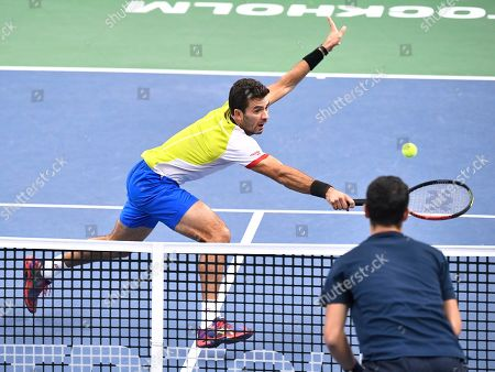 Jean-Julien Rojer (L) of the Netherlands in action during the men's doubles semifinal match against Mate Pavic of Croatia and Bruno Soares of Brazil at the ATP Stockholm Open tennis tournament at the Royal Tennis Hall in Stockholm, Sweden, 19 October 2019.