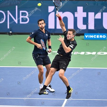 Mate Pavic (L) of Croatia and Bruno Soares of Brazil in action during the men's doubles semifinal match against Jean-Julien Rojer of the Netherlands and Horia Tecau of Romania at the ATP Stockholm Open tennis tournament at the Royal Tennis Hall in Stockholm, Sweden, 19 October 2019.